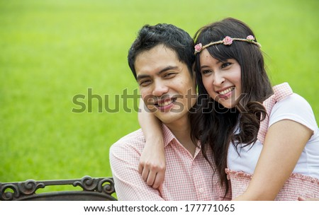 Lovely couple sit in the garden3