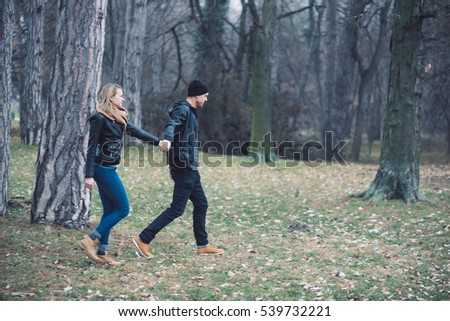 Lovely couple walking outdoor.