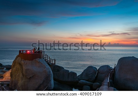 Lovely couple watching beautiful sunset over the sea at Koh Tao, Thailand - stock photo