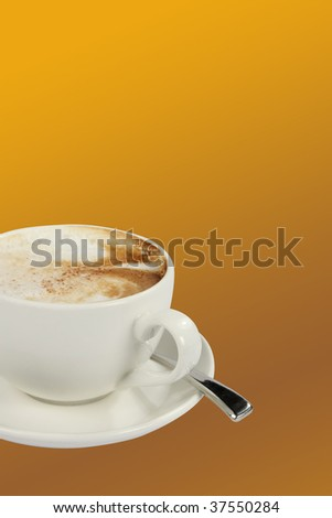 Lovely cup of coffee on an orange background - stock photo