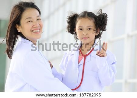Lovely doctor holding stethoscope pose in hospital - stock photo