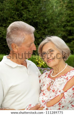 Lovely elderly couple went for a walk in the park