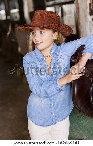 Lovely equestrian girl in the stable - stock photo