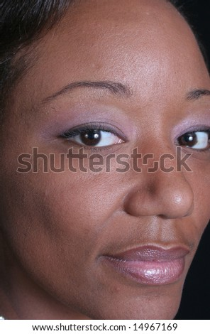 Lovely face of a African American woman - stock photo