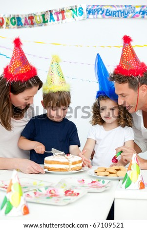 Lovely family celebrating a birthday together in the kitchen