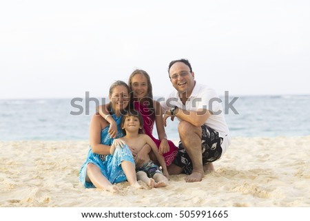 Lovely Family Enjoying at the beach in Summer