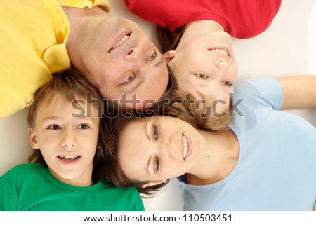 Lovely family in bright T-shirts on a white background