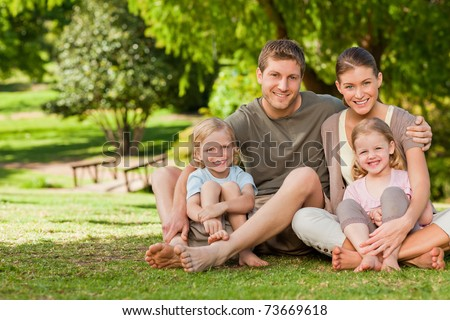 Lovely family in the park - stock photo
