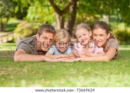 Lovely family in the park - stock photo