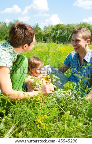 Lovely family playing in a sunny day