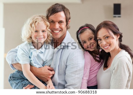 Lovely family posing while looking at the camera