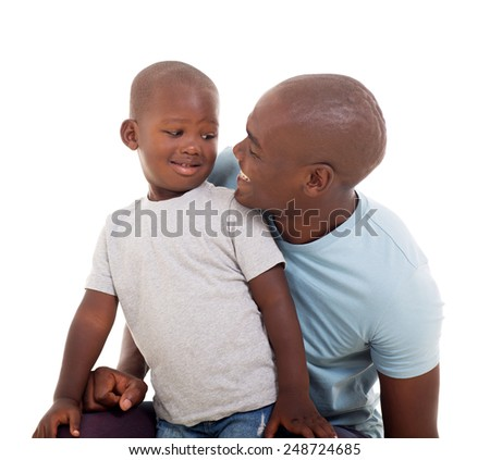 lovely father and son looking at each other on white background