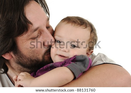 Lovely father is holding a little boy in his arms - stock photo