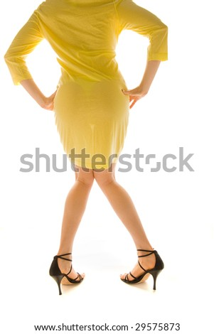 lovely female model with knees together from rear against white background