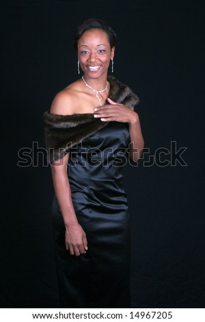 Lovely formal Black woman with eye contact and big smile - stock photo