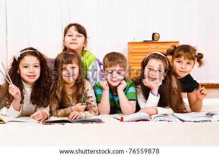 Lovely friends team reading books - stock photo