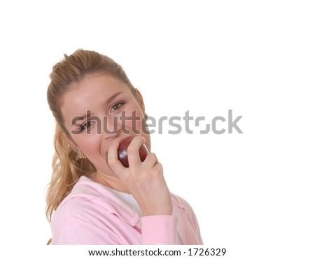 Lovely girl biting apple - stock photo