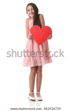Lovely girl holding a red heart shape, over white background. Love concept