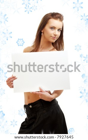 lovely girl holding blank sign board with snowflakes - stock photo