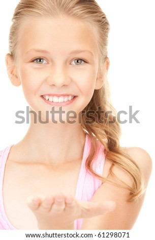 lovely girl holding something on the palm of her hand - stock photo