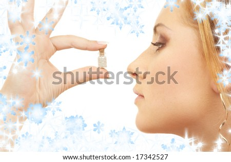 lovely girl holding tiny jar with mysterious potion - stock photo