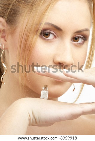 lovely girl holding tiny jar with mysterious potion
