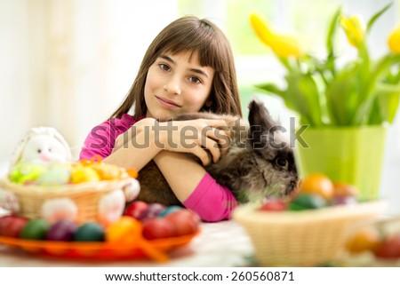 lovely girl hugging her  Easter bunny - stock photo