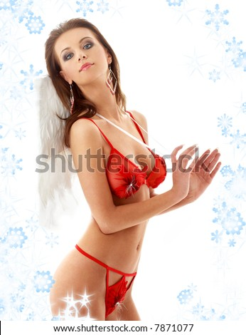 lovely girl in red lingerie with angel wings and snowflakes - stock photo