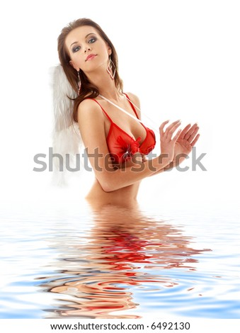 lovely girl in red lingerie with angel wings in water - stock photo