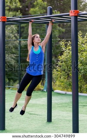 Lovely girl in sportswear on the playground. - stock photo