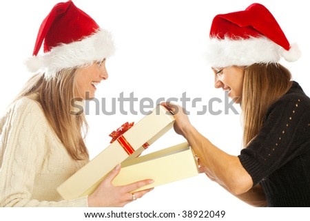 Lovely girl opening a present box from her friend - stock photo