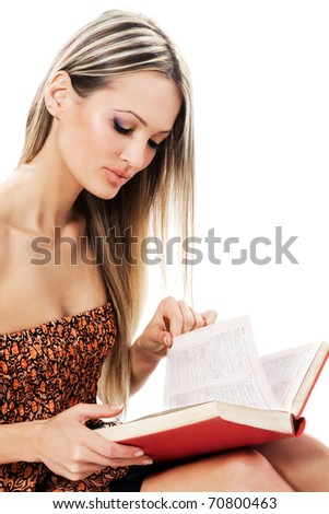 Lovely girl reading a book, white background