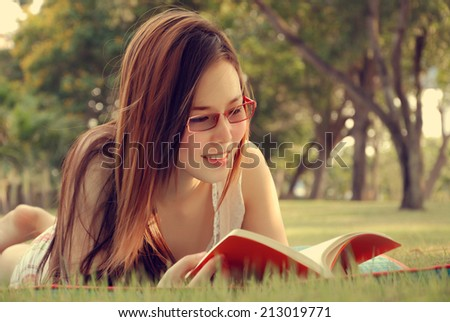 Lovely Girl Reading Book at Parks