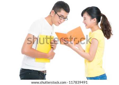 Lovely girl sharing curious book facts with her college friend - stock photo