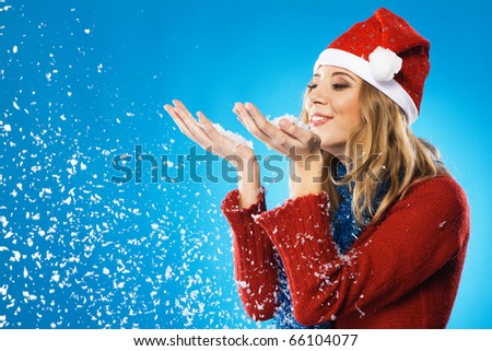 Lovely girl with a palms full of snow - stock photo