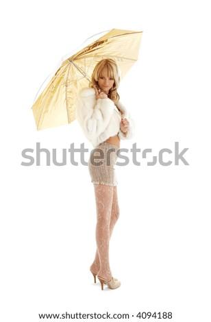 lovely girl with golden umbrella over white - stock photo