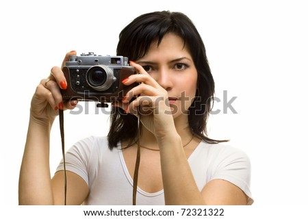 Lovely girl with old rangefinder camera isolated on white - stock photo