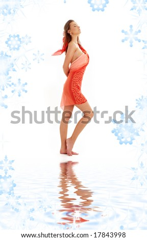 lovely girl with red sarong on white sand - stock photo