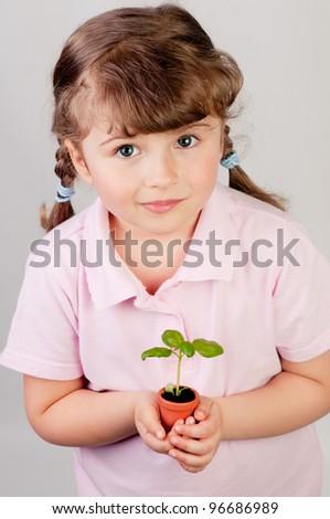 Lovely girl with seedling - stock photo