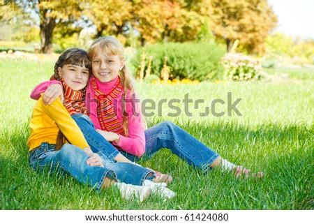 Lovely girls embracing - stock photo
