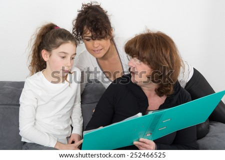 Lovely grandmother, daughter and daughter smiling on a white background - stock photo