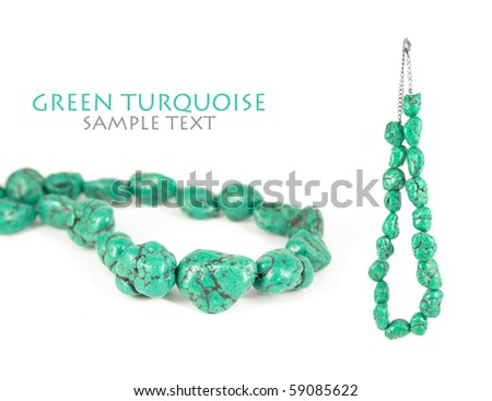 Lovely green turquoise necklace isolated on pure white background. Copy-space. - stock photo