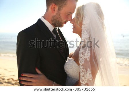 Lovely happy couple holding each other