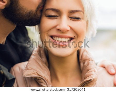 Lovely happy couple.romantic beautiful woman and handsome man.bearded boy and blond girl outdoor together - stock photo