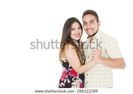 Lovely hispanic couple embraced in typical dance position