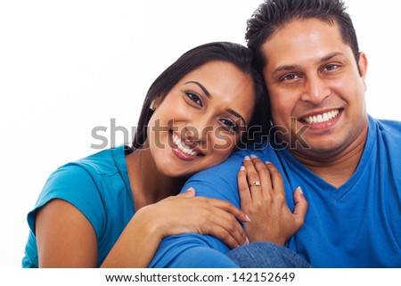 lovely indian husband and wife portrait, isolated on white - stock photo