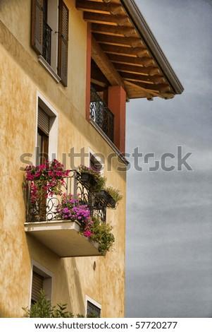 Lovely Italian house with balcony - stock photo