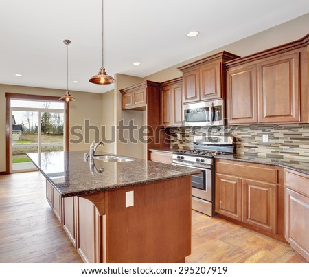 Lovely kitchen with bar island, and hardwood floor. - stock photo