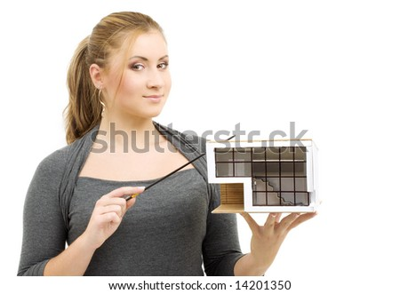 lovely lady with small house model and pointer in hands - stock photo