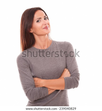 Lovely latin female in grey blouse looking at you while smiling in white background - stock photo